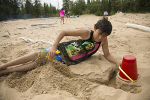Jared Monkman/NNSL photo Seth Beaulieu plays in the sand Friday afternoon with the K'atlodeeche First Nation summer camp.
