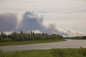 The smoke from a fire east of Hay River.  The fire was first reported on Friday