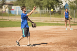 Jared Monkman/NNSL photo Joel Demarke throws the opening pitch in his team's game against Dettah Saturday afternoon at the Pine Point Ball Park.