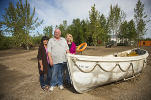 Jared Monkman/NNSL photo Linda Carter, left, Kirk Vander Ploeg, and Sheila Cook stand by a boat that sits in the newly renovated outdoor area of the Hay River Museum.