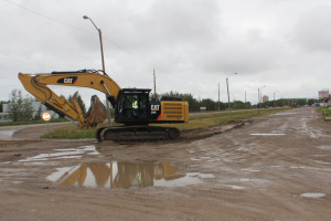 Paving work on Super A service road Aug. 21, 2015 Hay River Photo by Paul Bickford Northern News Services Ltd.
