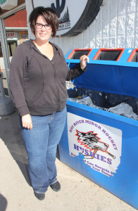 Pennie Pokiak President of Hay River Minor Hockey Standing by recylable collection bin at Rooster convenience store Sept. 4, 2015 Hay River Photo by Paul Bickford Northern News Services Ltd.