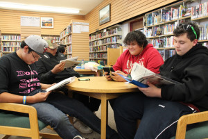 Diana Yeager/NNSL photo Many people in Hay River use NWT Centennial Library, including, left to right, Perry Lafleur, Ira Cayen, James Beaulieu and Hunter Kraushaar. The community can help fund the materials and resources in the library by supporting the annual Book Appeal.