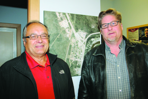 Joe Handley, left, and Brad Mapes – proponents of a wood pellet mill in Enterprise – heard good news at a Sept. 14 meeting of hamlet council when it agreed in principle to sell land for the project at a price discussed at an in-camera session.