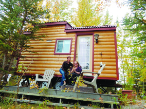 Klaudia Mika, left, sits with Sandra Lester in front of Lester's tiny house on Vale Island. Mika will host a presentation on Sept. 25 for people interested in building tiny houses.
