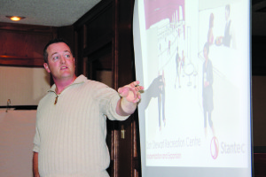 Coun. Jason Coakwell explains proposed improvements to the Don Stewart Recreation Centre in an appearance before the Hay River Chamber of Commerce on Sept. 23.