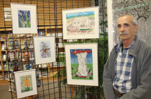 Chris Robson Standing in front of some of his artwork on display at NWT Centennial Library throughout October Oct. 2, 2015 Hay River Photo by Paul Bickford Northern News Services Ltd.