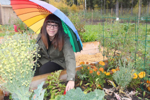 Marissa Oteiza from Ecology North Tending food-bearing plants at the Chief Sunrise Education Centre September 2015 Hay River Reserve Photo by Diana Yeager Northern News Services Ltd.