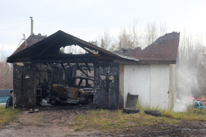 Shane Magee/NNSL photo Ricky Sonfrere's auto repair shop on the K'atlo'deeche First Nation, with a customer's vehicle inside, was destroyed by fire Oct. 16.