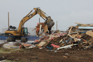 An excavator moves the remains of the Hay River Youth Centre structure after it was demolished Oct. 24.