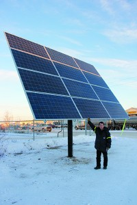 Bruce Sutherland, general sales manager of MSS Ltd., stands below a solar array recently erected in front of the business.
