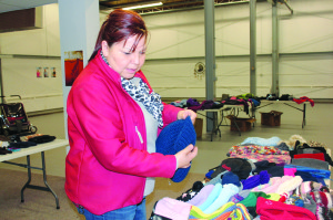Wendy Dumas sorts through hats donated for her project, Warm Coats for Winter November 2015 Hay River