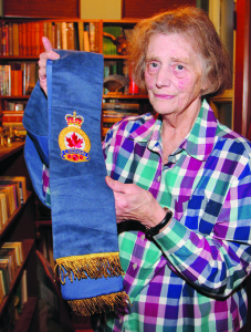 Vicky Latour displays the stole she has worn for 16 years as padre of Branch 250 of the Royal Canadian Legion.