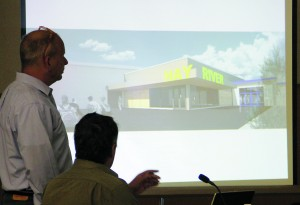 Consultants prepare a presentation on the proposed renovations to the Don Stewart Recreation Centre at a public information session in August.