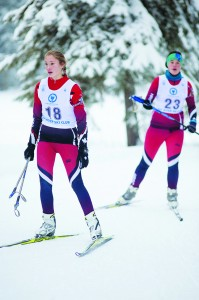 Michaela Crook, left, and Elli Cunningham, both of Hay River, round the last corner during a ski biathlon race on Dec. 12 during the territorial trials for the Arctic Winter Games.