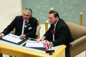 Shane Magee/NNSL photo NWT Commissioner George Tuccaro, left, and Hay River South MLA Wally Schumann pause for a photo during a swearing-in ceremony Dec. 8 at the legislative assembly.