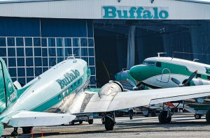 NNSL file photo Buffalo Airways' aircraft rest outside the Buffalo hanger at the Yellowknife airport July 12, 2014.