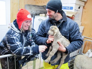 Kim Rapati, left, operations manager at the Northern Farm Training Institute, and Thomas Schenkel, the animal manager, discuss one of the new baby goats at the farm.
