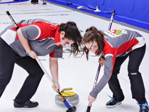 photo courtesy of Curling Canada Enterprise's Katherine Lenoir, left, and Hay River's Kaitlyn Ring of the NWT's junior women's team sweep a shot at the Canadian Junior Curling Championships.