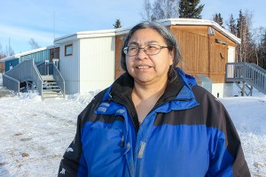 Paul Bickford/NNSL photo Sharon Pekok, the recreation director with K'atlodeeche First Nation, stands in front of a building on the Hay River Reserve which will be used as the home of a KFN Elders' Society, which is in the process of being created.