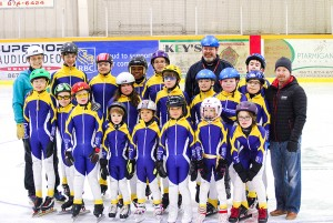Members of the Hay River Speed Skating Club got together for a team photo with their new racing suits. Members of the team include, in the front row, from left, Jon Tatti, Jacob Aylward, Colby Walters, Trey Wallington, Sebastian Berrub, Penelope Berrub, Lily Wallington and Mason Wallington. In the back row, from left, are Kirstin Mahler (assistant coach), Jack Coombs, Harrison Tweedie-Pitre, Anika Pellissey, Ksydalg Henry, Nicole Griffiths, Fynn Murrell, Spencer Tweedie-Pitre, Harry Scheper (head coach), Mason Walters, Ian Aylward, Jack Irwin (back) and Mark Harris from Norland Insurance, the team's uniform sponsor.