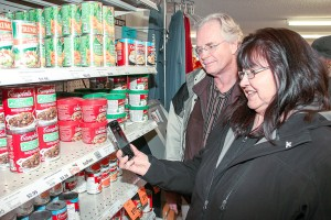 Paul Bickford/NNSL photo Brent Kaulback, left, the assistant superintendent with the South Slave Divisional Education Council, and Diane Tourangeau, the South Slavey language instructor at Chief Sunrise Education Centre, demonstrate how shoppers at Ehdah Cho Store on the Hay River Reserve can actually hear the South Slavey word for many products.