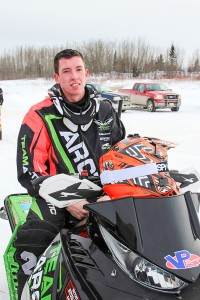 Diana Yeager/NNSL photo Brandon Bradbury from Yellowknife sits on his snowmobile at the Race Hay River cross-country finals on March 19.