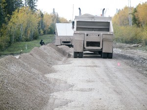 NNSL file photo A gravel truck works on Highway 5, about 70 kilometres west of Fort Smith, in September 2010, the last time there was a chipsealing project on the route.