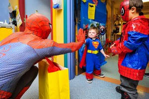 photo courtesy of Jennifer Tregidgo-Clavette Deagan Clavette, centre, celebrates his second birthday in Stollery Children's Hospital in Edmonton on March 12 with his brother Kaelin Clavette, right, and Spider-Man. Deagan has more than 25 known allergies and his reactions are life-threatening, forcing his family to relocate to Edmonton while they await a diagnosis and treatment.