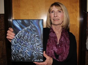 Paul Bickford/NNSL photo Sheila Cook displays a painting by Hay River artist Natacha Kruger that she received for being named Hay River Citizen of the Year, along with her friend Linda Carter.