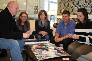 Diana Yeager/NNSL photo Hay Riveropoly committee members Steve Anderson, left, Anne Peters, Kandis Jameson, Joe Melanson and Dayna King try out the new board game created by the Hay River Chamber of Commerce.