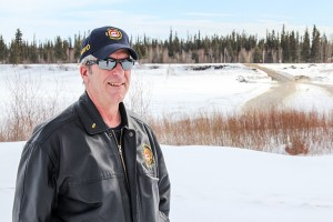 Diana Yeager/NNSL photo Ross Potter, the director of protective services with the Town of Hay River, stands by the frozen Hay River on April 15.