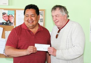 The Union of Northern Workers Local 6 made a $2,500 donation to the Hay River Seniors' Society on April 14. Local president Melvin Larocque, left, presented a cheque to John Brockway, the outgoing president of the society. The money is to assist with various initiatives of the society, including sending some members to the 2016 Canada 55+ Games in Ontario in August.