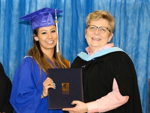 photo courtesy of Jayne Murray, Aurora College Savanna Fabian, left, of K'atlodeeche First Nation is presented with a certificate in early childhood development from Aurora College president Jane Arychuk during graduation ceremonies on April 22 in Fort Smith.