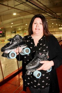 Paul Bickford/NNSL photo Dale Loutit, the recreation programmer with the Town of Hay River, holds one of the pairs of roller skates that people can borrow to try roller skating or roller derby at the ice-free arena.