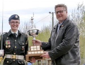 photo courtesy if Marge Osted Master Warrant Officer Grace Osted, left, receives the trophy for overall best cadet in 27294 Royal Canadian Army Cadet Corps from Mayor Brad Mapes.