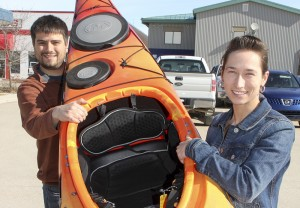 Paul Bickford/NNSL photo Craig Edwards, left, and Ashley Coombs, the aquatics supervisor for the Town of Hay River, hold a kayak outside the Don Stewart Recreation Centre.