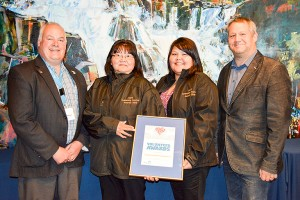 photo courtesy of the Department of Municipal and Community Affairs The K'amba Carnival Committee was the winner in the group category at the 2016 Outstanding Volunteer Awards. At the presentation ceremony in Yellowknife on May 6 were, left to right, Tom Williams, deputy minister for Municipal and Community Affairs; Diane Tourangeau, chairperson and a founder of the K'amba Carnival; Crystal Hope, a member of the K'amba Carnival Committee; and Glen Abernethy, minister of Health and Social Services.