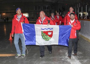 Paul Bickford/NNSL photo The teams competing at the NWT Track and Field Championships were led into the opening ceremonies on June 1 by a delegation from the GNWT, including, left to right: Jackson Lafferty, Speaker of the legislative assembly; Premier Bob McLeod; Education Minister Alfred Moses, and, back, right, Hay River North MLA Rocky (RJ) Simpson.