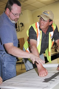 McBryan Drive area property owner Harry Scheper, left, talks with Earle Dumas, the director of public works with the Town of Hay River, at a public meeting on June 9.Harry Scheper, left, property owner Earle Dumas, right, director of public works with the Town of Hay River