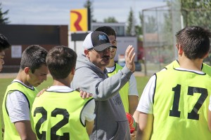 Paul Bickford/NNSL photo Fort Smith's Roger Vail, the assistant coach of the male team, offers directions to players at the 2017 Canada Summer Games identification camp held in Hay River from June 17 to 19.