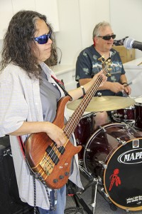 Bobbi Bouvier, left, on bass and Jim Constable, right, on drums entertain at a barbecue hosted by the Hay River Metis Government Council.