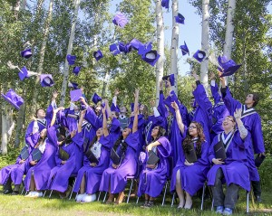 Shane Magee/NNSL photo The Diamond Jenness Secondary School graduating class of 2016 toss their caps into the air after a group picture to celebrate their graduation from the high school June 29. June 29, 2016