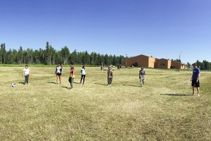 Alicia Korol photo courtesy of Mackenzie Recreation Association Participants in the Mackenzie Youth Summer Games play soccer on a field near the Chief Sunrise Education Centre on the Hay River Reserve.