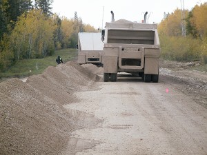 NNSL file photo A truck carries gravel for work on Highway 5 about 60 kilometres west of Fort Smith, during the last significant improvements to the route in 2010. That work was outside the boundaries of Wood Buffalo National Park.