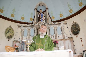 Paul Bickford/NNSL photo Father Don Flumerfelt at the altar of St. Ann's Roman Catholic Church on the Hay River Reserve.