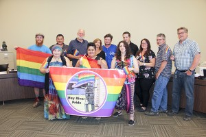 0308pri!_new Town council and residents pose for picture after council passed motion to paint crosswalk in Paul Bickford/NNSL photo Mayor Brad Mapes and town councillors suggested a picture with supporters of Hay River Pride on July 25 after council passed a motion to paint a crosswalk in the colours of the rainbow flag – a symbol of the LGBTQ community. In the celebratory photo are, front, left to right, Jessica Mandeville, Storm Larocque and Lindsay Anderson. In the back, from left, are Reiss Kruger, Coun. Vince McKay. Coun. Roger Candow, Coun. Kandis Jameson, Coun. Keith Dohey, Coun. Jason Coakwell, deputy mayor Donna Lee Jungkind, Coun. Mike Maher and Mayor Brad Mapes.