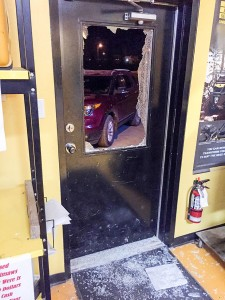 photo courtesy of the Hay River RCMP This front door was smashed during a break and enter at Monster Recreational Products on April 27. Five firearms were stolen during the break-in, and four of the guns have now been recovered near High Level.