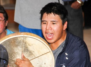 Paul Bickford/NNSL photo Mikale Eyakfwo of Gameti supports his team by drumming during the handgames tournament hosted by K'atlodeeche First Nation from July 30 to Aug. 1.