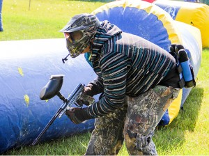 Paul Bickford/NNSL photo Phil Michaud stays low to avoid getting hit during paintball action on July 30 at the Old Town softball field.